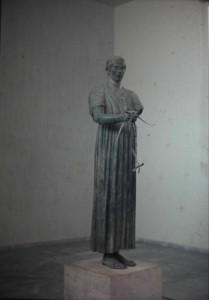 Museum of Delphi, famous statue. July 1965.